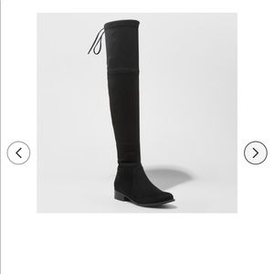 Over the knee black suede boots.